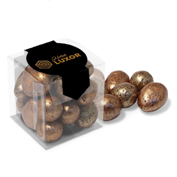 Small milk chocolate eggs in a clear plastic box with branded label.