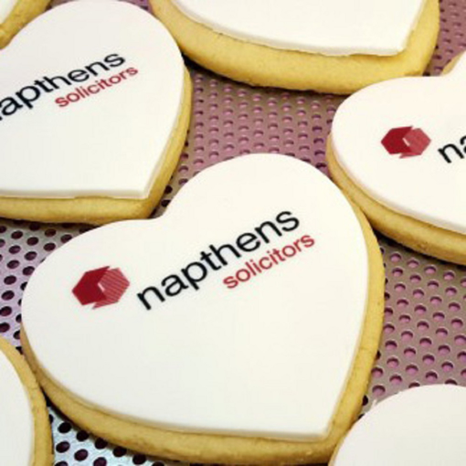 Branded heart shaped biscuits with printed icing