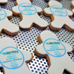 Branded people shaped biscuits with logo printed on topper