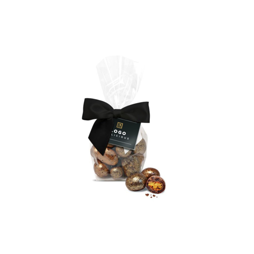 chocolate covered honeycomb in a bag with a branded tag
