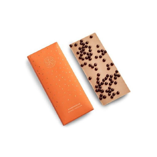 a white chocolate bar with gingerbread pearls