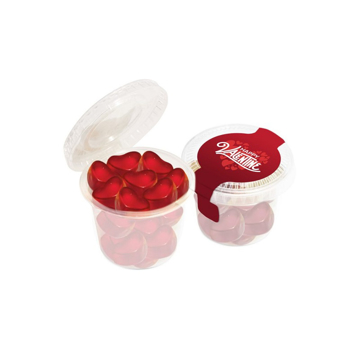 a small pot of red heart shaped sweets
